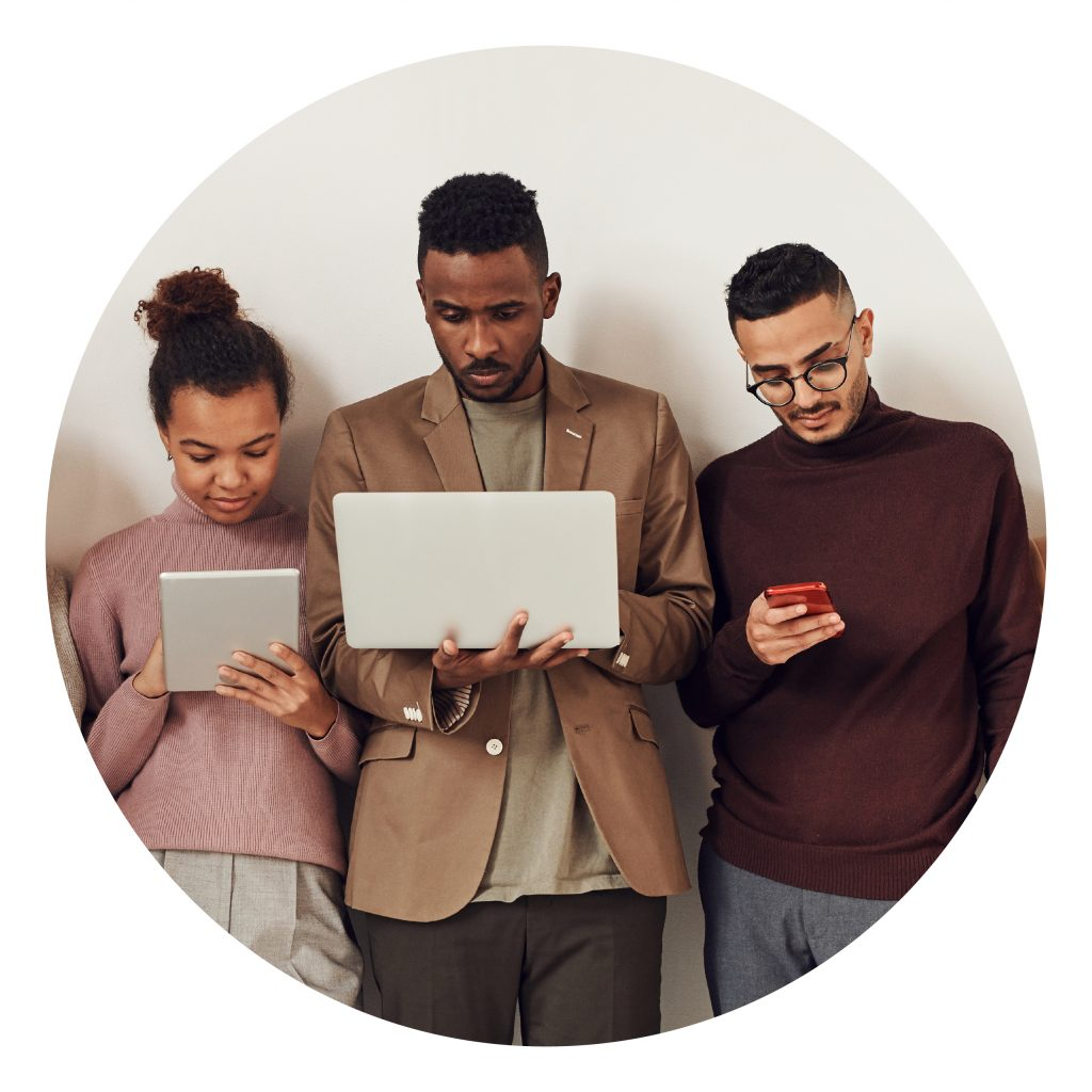 diverse co-workers on devices