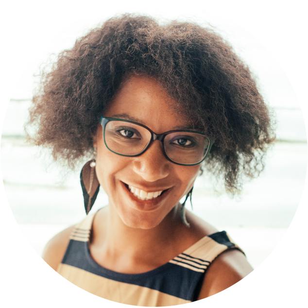 Curly black woman with big earrings smiling rounded frame