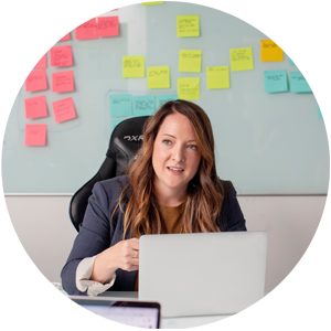 Woman having an online meeting, has sticky notes on a board behind her back