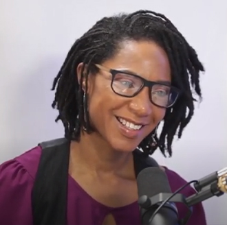 Lindsey T. H. Jackson speaking on the microphone