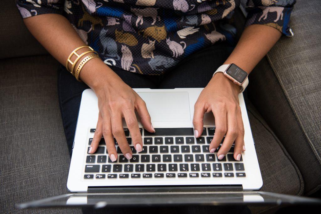 black woman writing on keyboard apple watch